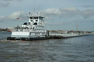 Pusher (boat) - The towboat Angelina pushes two loaded barges in New Orleans.