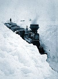 A snowbound locomotive, photographed on March 29, 1881, in western Minnesota.
