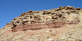 Sedimentary rock - Middle Triassic marginal marine sequence of siltstones (reddish layers at the cliff base) and limestones (brown rocks above), Virgin Formation, southwestern Utah, USA