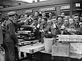 Troops evacuated from Dunkirk enjoying tea and other refreshments at Addison Road station in London, 31 May 1940. H1632.jpg
