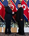 Trump shaking hands with Kim in Hanoi Summit (cropped).jpg