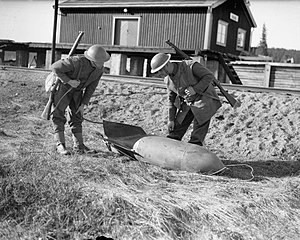 Namsos Campaign - Allied troops examine an unexploded German bomb at Grong Station in April 1940