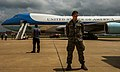 U.S. Air Force Airman 1st Class Jason Blackburn, foreground, with the 772nd Security Forces Squadron, provides security for Air Force One while President Barack Obama greets Airmen and family members May 26 130526-F-RH756-593.jpg