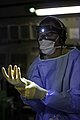 U.S. Air Force Lt. Col. Gerald Fortuna, a trauma surgeon with the 86th Medical Group, dons sterile gloves in preparation for a simulated in-flight surgery aboard a C-17 Globemaster III aircraft during the Joint 140117-F-RW714-597.jpg
