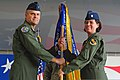 U.S. Air Force Lt. Col. Nicole Malachowski, right, passes the guidon to Col. Michael Koscheski, commander of the 4th Operations Group, during the 333rd Fighter Squadron's change of command ceremony at Seymour 130517-F-YG094-066.jpg