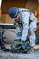 U.S. Army Capt. Robert Eberts, assigned to 1st Battalion, 4th Infantry Regiment, receives equipment for the urban lane task during the Joint Multinational Readiness Center's Expert Infantry Badge Competition 130806-A-HE359-124.jpg