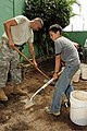 U.S. Army Sgt. 1st Class Joseph Infante, assigned to the 136th Engineer Company, Maine Army National Guard, works with a Boy Scout on improvements at the Mi Casa Orphanage in Santa Tecla, El Salvador, June 1 130601-A-OM689-001.jpg