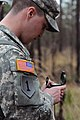U.S. Army Spc. Patrick Powers, a supply specialist with the 249th Quartermaster Company, 189th Combat Sustainment Support Battalion, shoots his azimuth during land navigation training of the Junior Leaders 130211-A-QD996-002.jpg