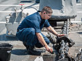 U.S. Navy Boatswain's Mate 2nd Class John Davis cleans an anchor chain during a fresh water wash down aboard the guided missile destroyer USS Stockdale (DDG 106) May 23, 2013, while operating in the U.S 130523-N-HN991-042.jpg