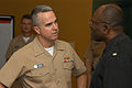 U.S. Navy Rear Adm. Alan T. Baker, left, the deputy chief of chaplains and the chaplain of the Marine Corps, talks with Lt. Cmdr. Edwin Carroll, the command chaplain of Naval Station Everett, Wash., Sept 080922-N-AI901-003.jpg