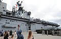 U.S. Sailors and family members wave to Sailors and Marines aboard the amphibious assault ship USS Boxer (LHD 4) upon the ship's arrival at Joint Base Pearl Harbor-Hickam, Hawaii, April 15, 2014 140415-N-IU636-102.jpg