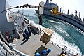 U.S. Sailors on the guided missile destroyer USS McCampbell (DDG 85), foreground, receive supplies during a replenishment at sea with the fleet replenishment oiler USNS Pecos (T-AO 197) during Foal Eagle 2013 130315-N-TG831-578.jpg