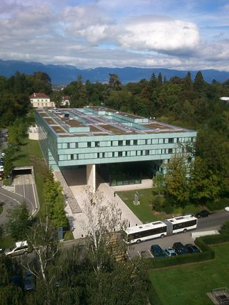 Joint United Nations Programme on HIV/AIDS - The UNAIDS building in Geneva, Switzerland, with the Jura Mountains in the background.