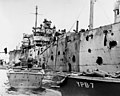 USS Mindanao (ARG-3) damaged by explosion of USS Mount Hood (AE-11) in Seeadler Harbor on 10 November 1944.jpg