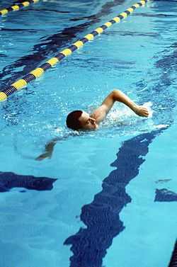 US Naval Academy midshipman learns swimming techniques at the Norman Scott Natatorium DN-ST-86-02832.jpg