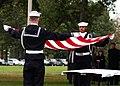 US Navy 021029-N-8327M-002 Honor Guard prepare to fold an American Flag for presentation to family members of Lieutenant Nicklous Benson.jpg