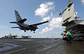 US Navy 030322-N-9964S-020 A Photographer's Mate takes a picture of an S-3B Viking landing on the flight deck.jpg