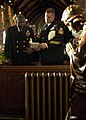 US Navy 031207-N-9565D-007 Chief Postal Clerk Andre Sermons from Los Angeles, Calif., and Chief Master-at-Arms Michele Hanson from Central Point, Ore., recite the Naval Prayer.jpg
