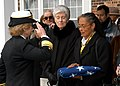 US Navy 040221-N-2899A-003 Rear Adm. Ann E. Rondeau salutes the National Ensign after presenting it to Sala Marilyn Steinbach, daughter of William Sylvester White.jpg