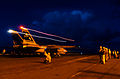 US Navy 040712-N-6213R-206 An F-14D Tomcat from the Tomcatters of Fighter Squadron Three One (VF-31) launches from one of four steam driven catapults during night operations on the flight deck aboard the aircraft carrier USS Jo.jpg