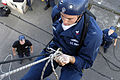 US Navy 040720-N-0683J-029 Fire Controlman 2nd Class Jason Larimer, assigned to the guided missile destroyer USS Shoup (DDG 86) practices repelling during a Visit Board Search and Seizure (VBSS) training evolution.jpg