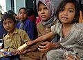US Navy 050104-N-9293K-088 An Indonesian family waits for food and humanitarian relief at Sultan Iskandar Muda Air Force Base in Banda Aceh, Sumatra, Indonesia.jpg
