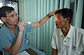 US Navy 050211-N-8796S-043 Dr. Steve Prepas, MD, an ophthalmologist from the non-governmental organization Project Hope checks a patient's eyes for cataracts at the University Hospital in Banda Aceh, Indonesia.jpg