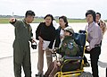 US Navy 050325-N-3122S-003 Lt.j.g. Matt Delgado, left, gives a tour of a P-3C Orion, assigned to the Tigers of Patrol Squadron Eight (VP-8), to Yuma Tanaka and his family during a flight-line tour at Kadena Air Base in Okinawa.jpg