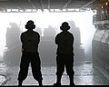 US Navy 050326-M-9114Y-055 Sailors assigned to the Deck Department aboard the amphibious assault ship USS Kearsarge (LHD 3), watch as a Landing Craft, Air Cushioned, assigned to Assault Landing Craft Unit Four (ACU-4), enters t.jpg