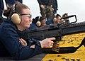 US Navy 050401-N-5313A-009 Culinary Specialist 3rd Class Conna Blackwell fires an M-60 machine gun.jpg