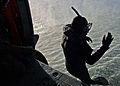 US Navy 050427-N-9500T-061 Aviation Electronics Technician 3rd Class Sam Crawford jumps from a MH-60S Seahawk helicopter during a search and rescue training flight.jpg