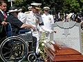 US Navy 050723-N-1026O-004 Mrs. Sybil Stockdale watches as Commander Naval Air Forces Vice Adm. James Zortman, place a rose upon the casket of retired Vice Adm. James B. Stockdale.jpg
