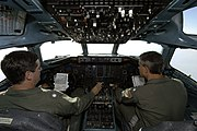 US Navy 050909-N-5328N-358 U.S. Navy Cmdr. James McSweeney, and Cmdr. Robert Velez, pilot a C-9 Skytrain cargo plane from the Hurricane Katrina staging area at Sherman Field aboard Naval Air Station Pensacola