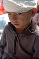 US Navy 051014-N-8796S-056 A Pakistani boy waits to receive medical attention after being airlifted by a U.S. Navy MH-53E Sea Stallion helicopter.jpg