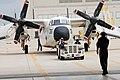 US Navy 060428-N-9689V-025 Fleet Logistics Support Squadron Three Zero (VRC-30) Sailors tow a C2-A Greyhound aircraft into the hangar for maintenance.jpg