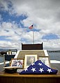 US Navy 070717-N-6674H-009 A combination cover, a few photographs and the American flag are placed on display in memory of Pearl Harbor survivor Chief Gunner's Mate Raymond Haack during a burial at sea held at the USS Uta.jpg