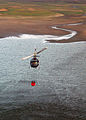 US Navy 071023-N-3069F-029 A civilian helicopter refills a bucket used to drop water in coordination with fire fighters and Navy pilots assigned to Helicopter Sea Combat Squadron (HSC) 85.jpg