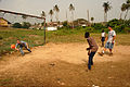 US Navy 071227-N-0193M-714 Operations Specialist Seaman Cody Thompson dives to block a soccer ball while playing with Construction Mechanic 1st Class Eric Dickinson and local children in Takoradi, Ghana.jpg