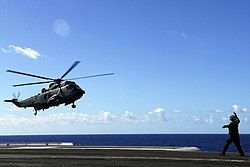 US Navy 080726-N-7883G-108 A CH-124 Sea King assigned to the Canadian 436 lands aboard the aircraft carrier USS Kitty Hawk (CV 63) after the conclusion of Rim of the Pacific 2008.jpg