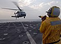 US Navy 081030-N-9134V-055 Seaman James Buchanan directs a MH-60S.jpg