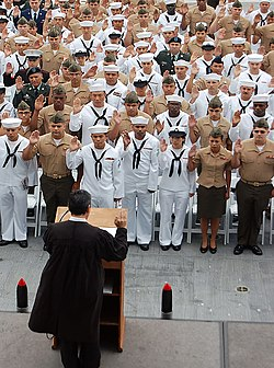 US Navy 090528-N-3207B-034 Sailors, Marines, Soldiers and Airmen recite the pledge of allegiance during a naturalization ceremony at the USS Midway Museum.jpg