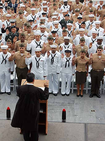 Service members are sworn in as citizens aboard the USS Midway in 2009 US Navy 090528-N-3207B-034 Sailors, Marines, Soldiers and Airmen recite the pledge of allegiance during a naturalization ceremony at the USS Midway Museum.jpg