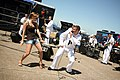 US Navy 090620-N-3271W-074 Musician Seaman Apprentice Steven Lamonica dances with an airshow patron during a performance by the U.S. Navy Band Great Lakes Horizon at the Quad Cities Airshow.jpg