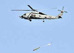 US Navy 090622-N-2638R-002 An SH-60B Sea Hawk helicopter assigned to the Warlords of Helicopter Anti-Submarine Squadron Light (HSL) 51 drops a MK-46 recoverable exercise torpedo.jpg