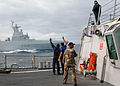 US Navy 090716-N-1655H-048 South African Sailors embarked on the guided-missile destroyer USS Arleigh Burke (DDG 51) wave to their native ship SAS Amatola (F145) during joint maneuvering drills.jpg