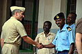 US Navy 090918-N-8138M-001 Cmdr. Paul V. Gomes, mission commander of Africa Partnership Station (HSV-2) Swift, shakes hands with SLt Al Hajji William, officer in charge of the Gambia Navy detachment, following a community relat.jpg