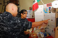 US Navy 091020-N-7544A-092 Sailors assigned to the Navy Operational Support Center (NOSC) read about Mexico's history during the Hispanic Heritage Month celebration.jpg