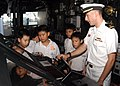 US Navy 100708-N-0995C-052 Lt. j.g. Chris Malta, electrical officer aboard the guided-missile cruiser USS Princeton (CG 59), explains the lee helmsman watch to students from a Singaporean elementary school.jpg