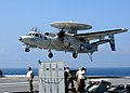 US Navy 100715-N-5446H-385 An E2-C Hawkeye prepares to land aboard USS George H.W. Bush (CVN 77).jpg