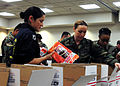 US Navy 101119-N-5148B-001 Members of the Naval Special Warfare Junior Enlisted Association and other volunteers from the command prepare holiday c.jpg